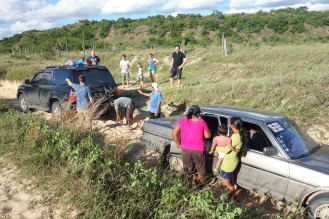 Rescuing a car stuck in the sand! Pleased to have managed a little conversation with lovely Bolivian lady and her baby in my broken Spanish